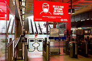 As the UK's Conornavirus pandemic lockdown continues, but with travel restrictions and social distancing rules starting to ease after three months of closures and isolation, Transport for London is following the government's call for face coverings to be worn on all public transport from June 15th next week, at the barriers of London Underground's Canary Wharf station, on 9th June 2020, in London, England.