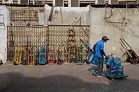 UNITED ARAB EMIRATES, DUBAI - CIRCA JANUARY 2017: Man walks in Deira, on some of the back streets of the Gold Souq in Dubai