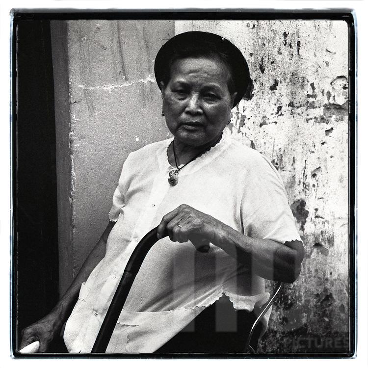 Portrait of an old Vietnamese woman, Hanoi, Vietnam, Southeast Asia