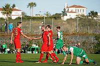 *Illiass Bel Hassani* of AZ Alkmaar (2vl) scores the third goal to make it 2-1, *Jelle Duin* of AZ Alkmaar (l), Muheim Miro Max Maria of FC St Gallen (r)