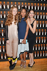 Left to right, LILY COLE, NAOMIE HARRIS and LAETITIA CASTA at the Cointreau Creative Crew Award at Liberty, Great Marlborough Street, London on 24th May 2016.