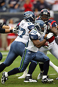 Seattle Seahawks running back Justin Forsett (20) runs the ball in traffic during the NFL football game against the Houston Texans on December 13, 2009 in Houston, Texas. The Texans won the game 34-7. ©Paul Anthony Spinelli