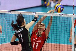 Japan Mai Yamaguchi spikes against Belgium Els Vandesteene