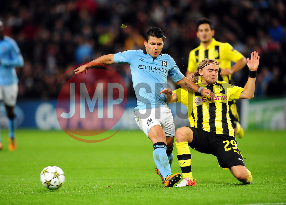 Borussia Dortmund's Marcel Schmelzer tackles Manchester City's Sergio Aguero - Photo mandatory by-line: Joe Meredith/JMP  - Tel: Mobile:07966 386802 03/10/2012 - Manchester City v Borussia Dortmund - SPORT - FOOTBALL - Champions League -  Manchester   - Etihad Stadium -