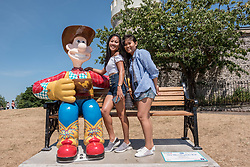 "© Licensed to London News Pictures.  02/07/2018; Bristol, UK. Gromit Unleashed 2. Emily Knowles and Anna Gonzales pose with ""The Wensleydale Kid"" Wallace character installed at the Clifton Observatory for the Gromit Unleashed 2 sculpture trail. Gromit Unleashed 2, which officially begins on 02 July, will see the Academy Award®-winning character Gromit by Nick Park at Aardman Animations returning to Bristol in 2018 for the second time on sculpture trails to raise money for  the Grand Appeal charity. The character of Gromit will be joined by Wallace and their arch nemesis Feathers McGraw. The trail will feature over 60 giant sculptures designed by high-profile artists, designers, innovators and local talent. Sculptures will be positioned in high footfall and iconic locations around Bristol and the surrounding area. Photo credit: Simon Chapman/LNP"
