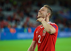 LILLE, FRANCE - Friday, July 1, 2016: Wales' Chris Gunter celebrates with his 'chin up' gesture after a 3-1 victory over Belgium and reaching the Semi-Final during the UEFA Euro 2016 Championship Quarter-Final match at the Stade Pierre Mauroy. (Pic by David Rawcliffe/Propaganda)