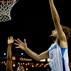 Mar 18, 2013; New Orleans, LA, USA; New Orleans Hornets center Robin Lopez (15) shoots over Golden State Warriors small forward Harrison Barnes (40) during the first quarter a game at the New Orleans Arena Mandatory Credit: Derick E. Hingle-USA TODAY Sports