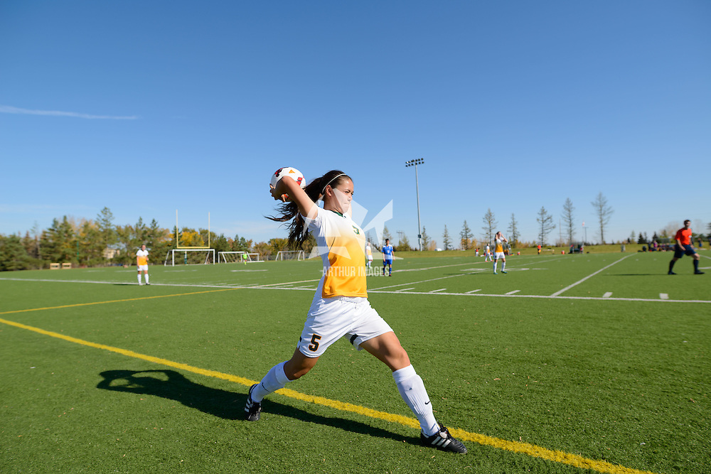 3rd year defender Angela Lalonde (5) of the Regina Cougars makes a throw from the sideline during the women's soccer home game on October 1 at U of R Field. Credit: Arthur Ward/Arthur Images