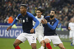 France's Adil Rami battling Uruguay's Edinson Cavani during France v Uruguay friendly football match at the Stade de France in Saint-Denis, suburb of Paris, France on November 20, 2018. France won 1-0. Photo by Henri Szwarc/ABACAPRESS.COM