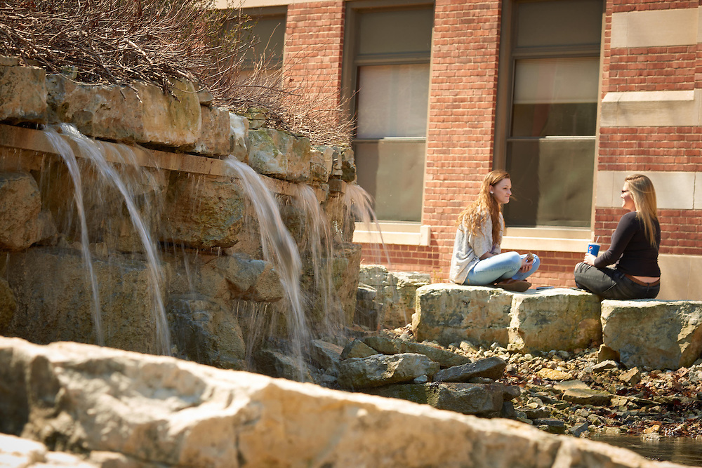 Activity; Talking; Socializing; Buildings; Graff Main Hall; Location; Outside; People; Student Students; Woman Women; Spring; April; Time/Weather; sunny; Type of Photography; Candid; UWL UW-L UW-La Crosse University of Wisconsin-La Crosse; Waterfall