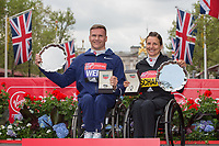 David Weir GBR and Manuela Schar SUI smile with their winning salvers following their victories in the Elite Wheelchair races. The Virgin Money London Marathon, 23rd April 2017.<br /> <br /> Photo: Jed Leicester for Virgin Money London Marathon<br /> <br /> For further information: media@londonmarathonevents.co.uk