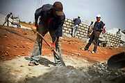 A Chinese foreman supervises Guinean workers on the construction site of the Kipe hospital in Conakry, Guinea on Wednesday March 4, 2009. The Kipe hospital is a 10 million dollars project entirely funded by the Chinese government. (Olivier Asselin for the New York Times)
