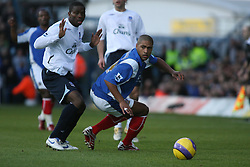 PORTSMOUTH, ENGLAND - SATURDAY, DECEMBER 9th, 2006: Glen Johnson of Portsmouth clashes with Joseph Yobo of Everton during the Premiership match at Fratton Park. (Pic by Chris Ratcliffe/Propaganda)