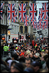 Union Jack Flags hang in Leicester Square, Wednesday May 9, 2012. As visitors flock to London for the Olympics. Photo By Andrew Parsons/ i-Images