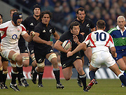 2005 Rugby, Investec Challenge, England vs New Zealand, All Black, 2005 Rugby, Investec Challenge, England vs New Zealand, All Black, Byron Kellemer breaking, with Danny Grewcock [cap] and Charlie Hodgeson tackling   RFU Twickenham, ENGLAND:     19.11.2005   © Peter Spurrier/Intersport Images - email images@intersport-images.. No. 10 moving in to challenge.    RFU Twickenham, ENGLAND:     19.11.2005   © Peter Spurrier/Intersport Images - email images@intersport-images...