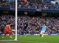 MANCHESTER, ENGLAND - Sunday, November 24, 2013: Manchester City's Sergio Aguero scores the third goal against Tottenham Hotspur during the Premiership match at the City of Manchester Stadium. (Pic by David Rawcliffe/Propaganda)