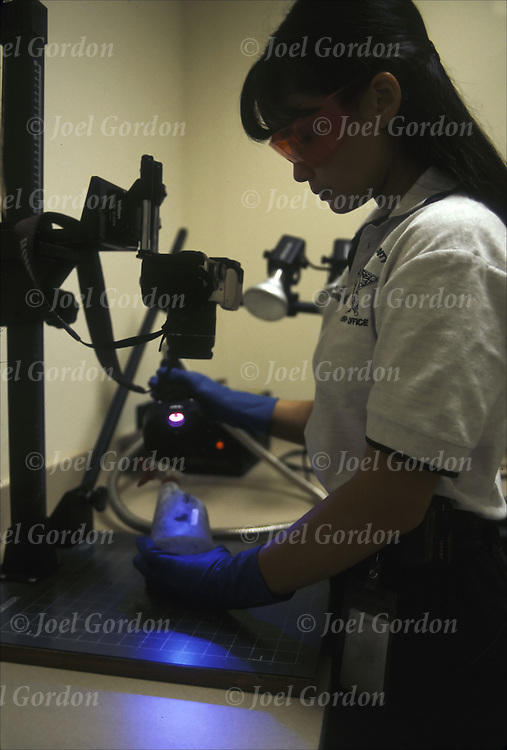 Forensics, CSI, examiner setting up alternative light source, blue light, for processing of latent prints, Orange County Sheriff's Office, FL