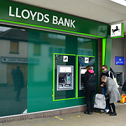 During the coronavirus in UK lockdown people taking money our of Lloyds Bank,on 28 March 2020, at Walthamstow Market, London.