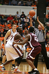 Tunji Soroye (21) prepares for the opening jump ball against Fordham.  UVA lost the game 62-60...The Virginia Cavaliers fell to the Fordham Rams 62-60 at University Hall in Charlottesville, VA on December 7, 2005.
