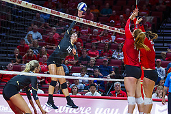 BLOOMINGTON, IL - September 14: Kristina Fisher strikes towards Sydney Holt during a college Women's volleyball match between the ISU Redbirds and the University of Central Florida (UCF) Knights on September 14 2019 at Illinois State University in Normal, IL. (Photo by Alan Look)