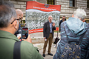 John McInally speaking at the Pay Cap demo.  PCS members working in the civil service are holding a short, high profile protest to demonstrate about the continued 1% pay cap public sector pay cap that has been in place for 7 years.Westminster,  London,  United Kingdom. (Photo by Andy Aitchison / PCS)