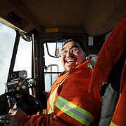 Ian Stewart/Yukon News<br /> Elvis Wolki runs a blower on the highway near Sheep Creek.