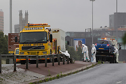 © licensed to London News Pictures. Salford, UK FILE PHOTO DATED 18/07/2011. 04/05/2012 The scene where Kirk Bradley escaped following the hijacking of a G4S security van during the morning rush hour in Manchester on 18th July 2011. Mr Bradley has been arrested in Amsterdam today (5th April) say the Serious Organised Crime Agency. Another prisoner, Anthony Downes, also escaped during the same incident. He was caught in March. The hijacking took place on the Trinity Way bridge, linking Salford and Manchester. Following the incident, the bridge was closed off for foresnsic examiners. Please see special instructions for usage rates. Photo credit should read Joel Goodman/LNP