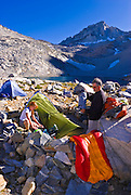 Climbers in camp at Dade Lake under Bear Creek Spire, John Muir Wilderness, Sierra Nevada Mountains, California