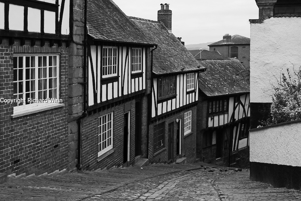 Black and White image of Stepcote Hill, one of the few remaining cobbled streets left in Exeter.