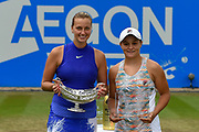 Petra Kvitova of the Czech Republic  and Ashleigh Barty of Australia hold their trophies after the Final of the Aegon Classic Birmingham at Edgbaston Priory Club, Edgbaston, United Kingdom on 25 June 2017. Photo by Martin Cole.
