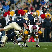 Notre Dame linebacker, Manti Teo goes airborne in an effort to stop USC Tight End Anthony McCoy during a long gain by the Trojans which resulted in a touchdown in the Trojans 34-27 victory over the Irish.  Photo by Barry Markowitz, 10/17/09, 5pm