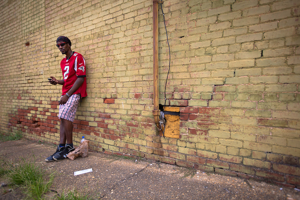 "Trey Boyd, a resident of Buchanan, Ga., stands outside a downtown building there on Thursday, July 2, 2015. He says that Confederate flag doesn't bother him. ""It stands for our country and what we fought for and what we went through,"" he said. ""It stands for U.S.A."" Shot for a story about changes occurring in the South following a heightened national awareness and sensitivity concerning the Confederate battle flag. Photo by Kevin Liles for The New York Times"
