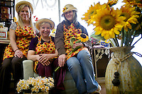 Valerie Cooper, center, owner of the decor and flower store called Sunflower, will open the business April 24 with the assistance of her daughter, Amanda Caetano, right, and Jodie Hobson.