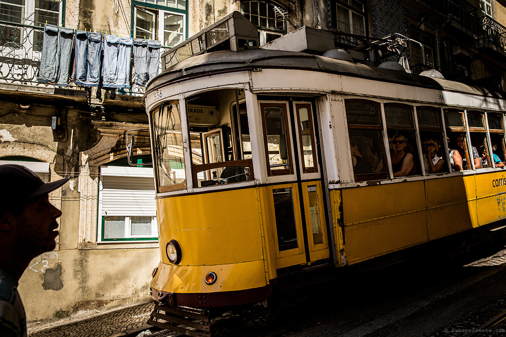 Man passing by a tram in Lisbon. Portugal