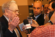 5/1/04 Omaha, Neb.  Warren Buffett speaks to the media during the  Berkshire Hathaway shareholders meeting at Qwest Center Omaha Saturday morning. (Photo by chris machian)