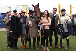 Alex Edwards, owner Mrs D Williams and trainer Philip Rowley celebrate victory after the St. James' Place Foxhunter Challenge Cup Open Hunters' Chase during Gold Cup Day of the 2019 Cheltenham Festival at Cheltenham Racecourse.