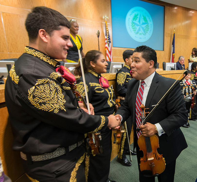 Richard Carranza talks with members of the Heights Mariachi after being hired to be superintendent of the Houston ISD, August 18, 2016.