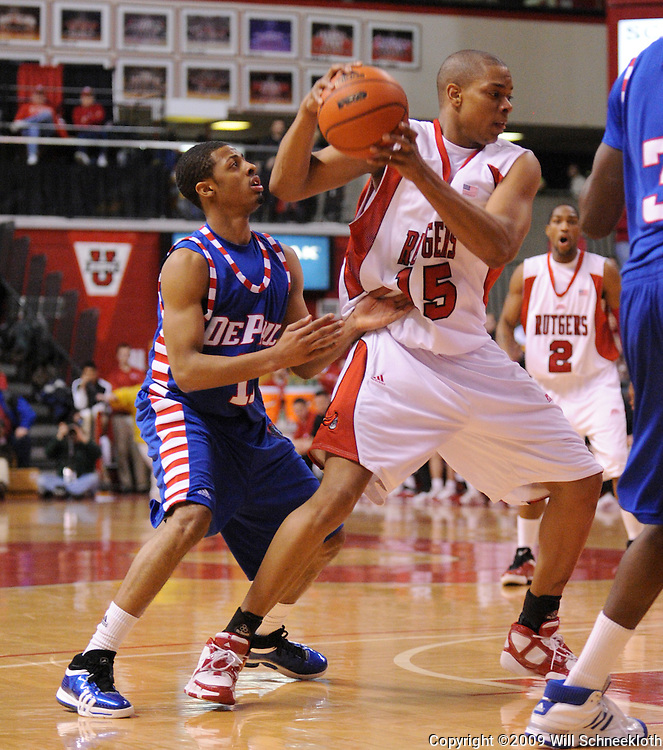 Jan 31, 2009; Piscataway, NJ, USA; Rutgers forward J.R. Inman (15) controls an offensive rebound during the first half of Rutgers' 75-56 victory over DePaul in NCAA college basketball at the Louis Brown Athletic Center