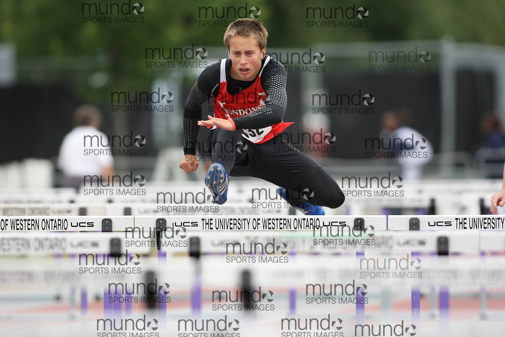 (London, Ontario---13/06/09)   Jacob Crombeen of London Legion T&F Alliance competes in the  sprint hurdles at the 2009 Athletics Ontario Junior Track and Field Championships. The meet was held in London, Ontario from June 13-14, 2009. Copyright photograph Sean Burges / Mundo Sport Images, 2009. www.mundosportimages.com / www.msievents.