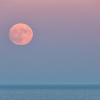 Super Moon rises off of Cape Cod National Seashore, Massachusetts