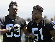 May 28, 2019; Alameda, CA,  USA; Oakland Raiders linebackers Jason Cabinda (53) and Vontaze Burfict (51) during organized team activities at the Raiders practice facility.