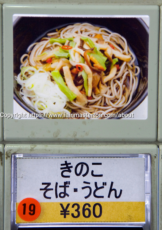 Detail of button and photo of meal on food ticket vending machine at noodle restaurant in Tokyo Japan