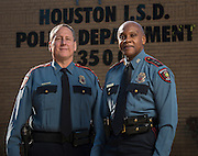 Incoming Houston ISD Chief of Police Robert Mock, left, and retiring Chief Jimmy Dotson, right, pose for a photograph at the headquarters building, December 18, 2013.