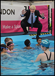 Mayor Boris Johnson with Team GB synchronised swimming looks at a mobile swimming pool in action at Maria Fidelis School in Camden as part of the Mayors 'Make a Splash initiative, London<br /> Thursday, 30th May 2013<br /> Picture by Andrew Parsons / i-Images