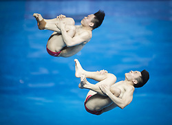 WUHAN, June 5, 2018  China's Cao Yuan (R) and Xie Siyi compete during the men's 3m springboard synchronised final at the FINA Diving World Cup 2018 in Wuhan, central China's Hubei Province, on June 5, 2018. Cao Yuan and Xie Siyi claimed the title with a total of 448.74 points. (Credit Image: © Xiao Yijiu/Xinhua via ZUMA Wire)