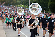Led by members of the March 110, members of the Ohio University Class of 2018 proceed up Richland Avenue after the New Student Convocation on Aug. 24, 2014. Photo by Lauren Pond