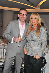 CHARLES DENTON CEO of Erno Laszlo and MEG MATTHEWS at a lunch hosted by Harrods' and Erno Laszlo to celebrate the launch of the Erno Laszlo Hollywood Collection held in The Penthouse, Harrods, Knightsbridge, London on 25th April 2012.