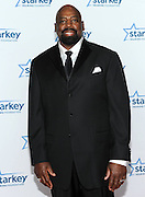 "Former NFL player Ed Jones is seen on the red carpet at the Starkey Hearing Foundation's ""So the World May Hear"" Awards Gala on Sunday, July 20, 2014 in St. Paul, Minn. (Photo by Diane Bondareff/Invision for Starkey Hearing Foundation/AP Images)"