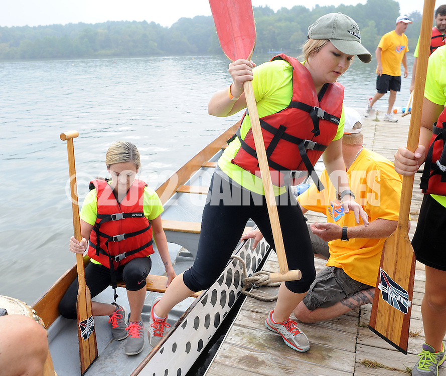 PDRAGON20P<br /> From left, Christen Stick and Trisha Coulton exit their team boat, NFP Executive Benefits after their heat during the first annual Bucks County Dragon Boat Festival on Lake Luxembourg at Core Creek Park Saturday September 19, 2015 in Langhorne, Pennsylvania.  The purpose of the event is to Paddle Out Hunger with proceeds benefitting Bucks County Housing Group. (William Thomas Cain/For The Inquirer)
