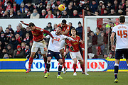 Nottingham Forest defender Michael Mancienne challenges Bolton Wanderers striker Gary Madine during the Sky Bet Championship match between Nottingham Forest and Bolton Wanderers at the City Ground, Nottingham, England on 16 January 2016. Photo by Alan Franklin.